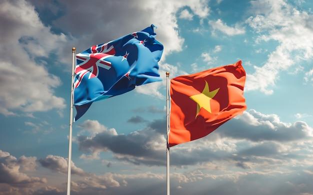 Bandiere della nuova zelanda e del vietnam sullo sfondo del cielo