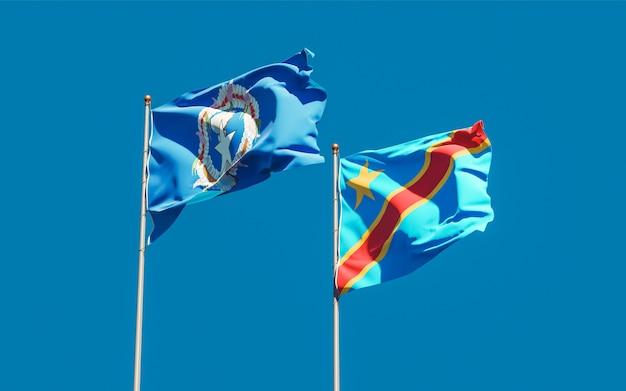 Bandiere delle isole marianne settentrionali e della repubblica democratica del congo sul cielo blu. grafica 3d