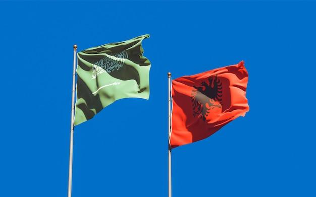 Bandiere dell'arabia saudita e dell'albania. grafica 3d