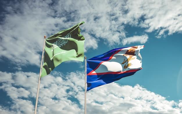 Bandiere dell'arabia saudita e delle samoa americane. grafica 3d