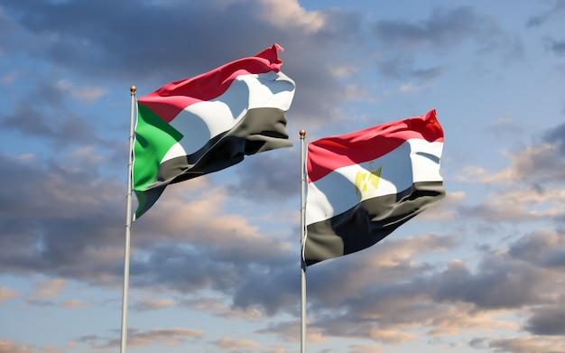 Bandiere del sudan e dell'egitto. grafica 3d