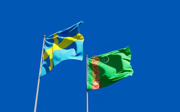 Bandiere del turkmenistan e della svezia sul cielo blu. grafica 3d