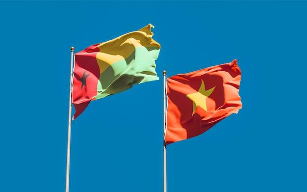 Bandiere del vietnam e della guinea-bissau. grafica 3d