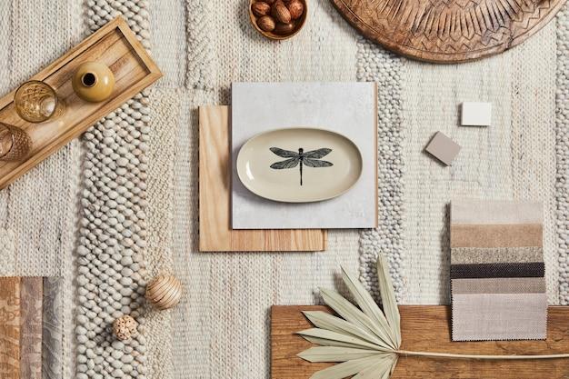 Design piatto della composizione moodboard dell'architetto creativo con campioni di costruzione, tessuto beige e materiali naturali e accessori personali. vista dall'alto, modello.