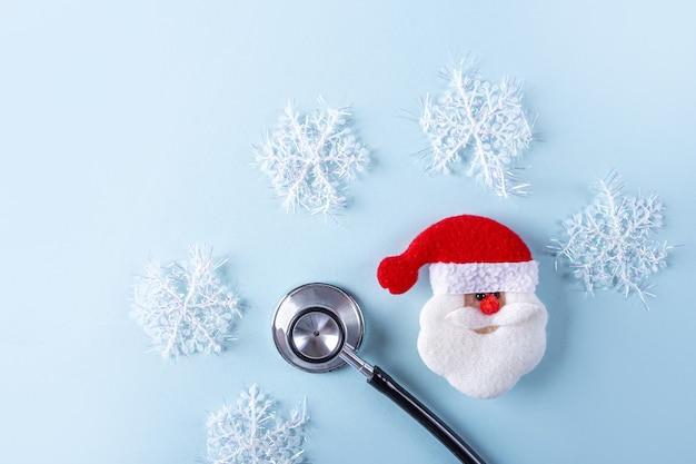 Composizione di natale medica piatta laici con lo stetoscopio