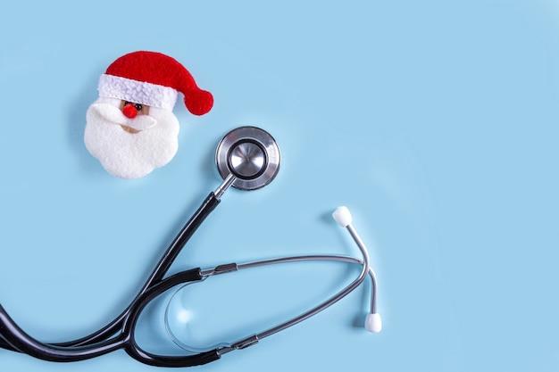 Composizione di natale medica piatta laici con lo stetoscopio,