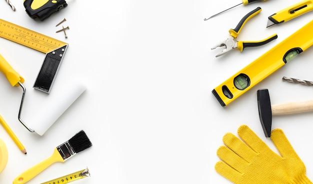 Telaio di strumenti di riparazione piatto lay con copia spazio
