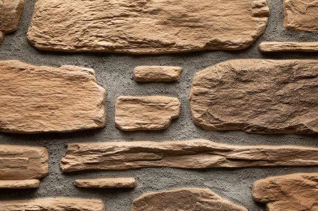 Flatlay della parete di superficie solida decorativa marrone chiaro