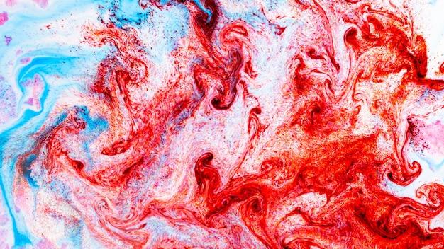 Arte fluida. fondo variopinto astratto, carta da parati. sfondo colorato alla moda