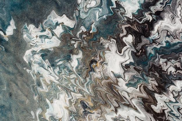 Arte fluida. fondo o struttura ondulato astratto. zigzag bianchi, neri e blu. rumore di particelle d'oro.