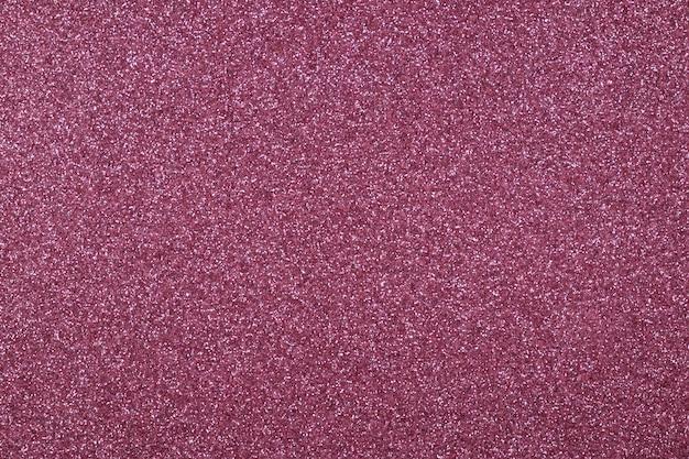 Sfondo di glitter astratto liliaco focalizzato