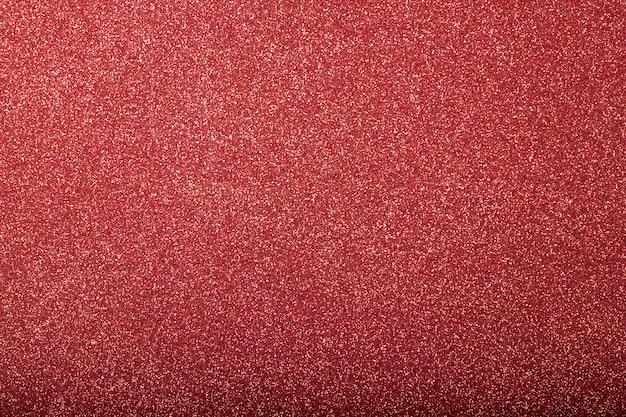 Sfondo rosso glitterato focalizzato