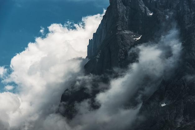 Foggy mountain cliff.