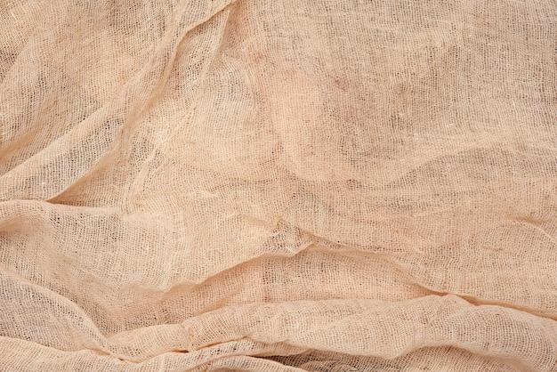 Tovagliolo piegato in garza di cotone beige