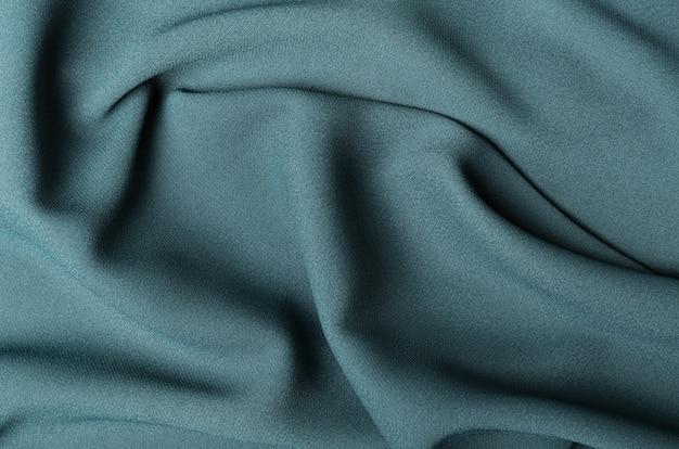 Pezzo piegato di tessuto verde