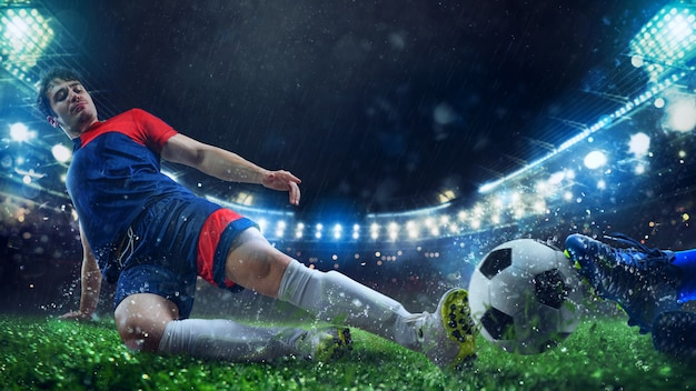 Scena di calcio con giocatori di calcio in competizione allo stadio