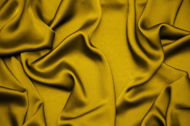 Sfondo di seta tessuto drappeggiato color oro fortuna