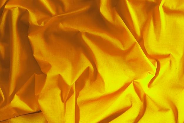 Fondo di struttura del tessuto di seta oro fortuna