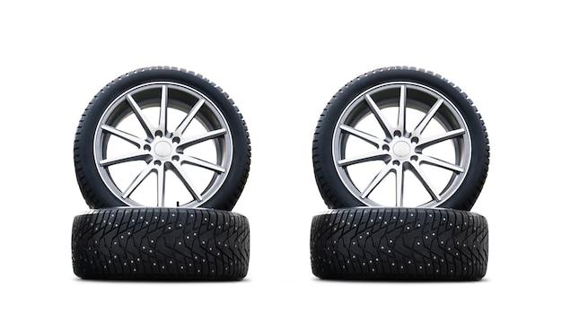Quattro nuove belle gomme da neve isolate su uno sfondo bianco. un set di pneumatici per auto invernali chiodati. un set di ruote e pacchetti di pneumatici. parti di ruote invernali.