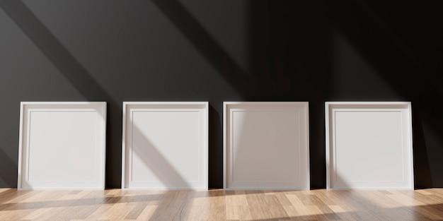 Quattro cornici bianche verticali sulla parete nera