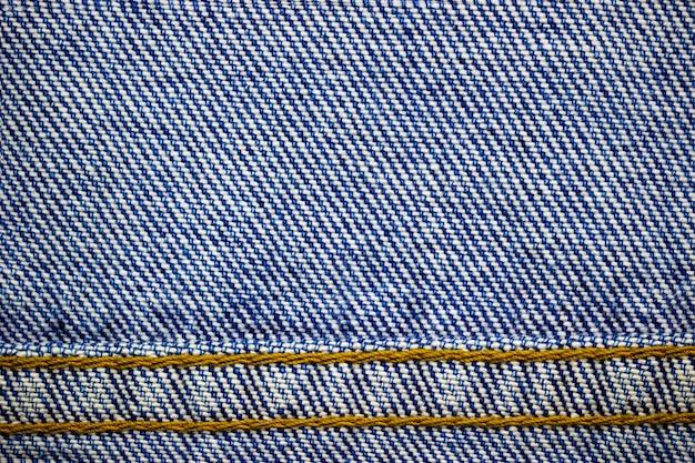 Cornice o bordo del punto tessuto jeans. di abiti vintage o moda.