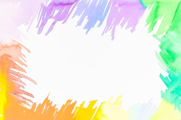 Telaio realizzato con pennellate colorate design con spazio per la scrittura del testo su sfondo bianco