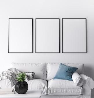 Cornice dal design moderno del soggiorno, tre cornici nere su un muro bianco brillante