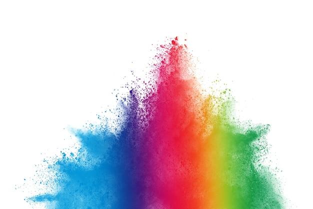 Blocca il movimento della polvere colorata che esplode su sfondo bianco.