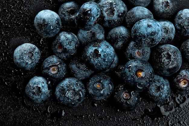 Mucchio di mirtilli antiossidanti naturali freschi, macro dettagliate da vicino.