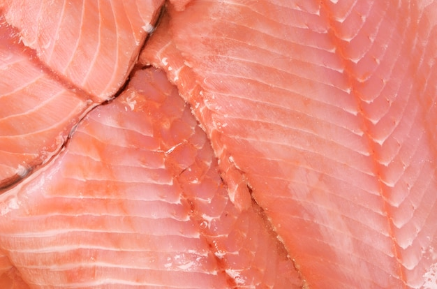 Fine rossa fresca di struttura del salmone su