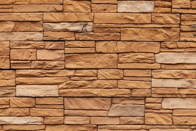 Mattoni frontali di mattoni arancioni. materiali moderni per la costruzione di una casa