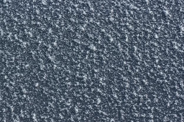 Frost o brina sul vetro, sfondo invernale.
