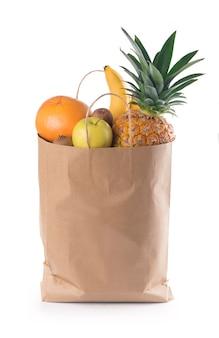 Frutta e verdura in sacchetto della spesa di carta isolato su sfondo bianco