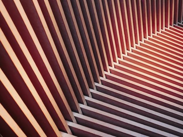 Full frame pattern sullo sfondo del sedile di barre di legno con luce e ombra