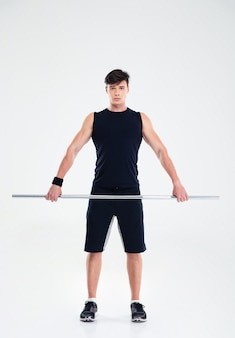 Ritratto a figura intera di un bel allenamento di fitness con bilanciere isolato