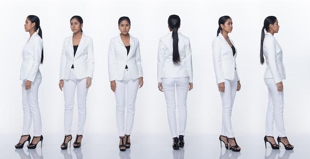 Figura intera a scatto, donna d'affari asiatica in piedi in bianco vestito formale adeguato pantaloni e scarpe, illuminazione studio sfondo bianco isolato, avvocato capo atto posa sorriso sguardo intelligente