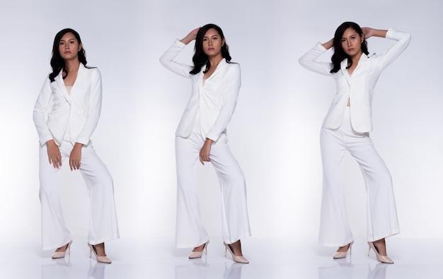 Figura intera a scatto, donna asiatica d'affari transgender indossa pantaloni bianchi pantaloni capelli neri e agisce in molte pose espressione, studio illuminazione sfondo bianco gruppo collage isolato