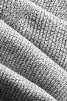 Una pagina intera di trama grossa grigio scuro degli articoli in maglia