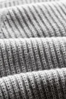 Una pagina intera di trama del tessuto di maglieria grigio scuro