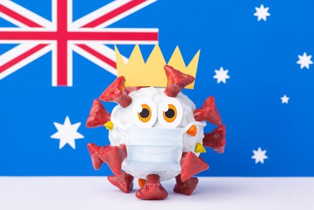 Divertente modello 3d influenzale del coronavirus davanti alla bandiera australiana