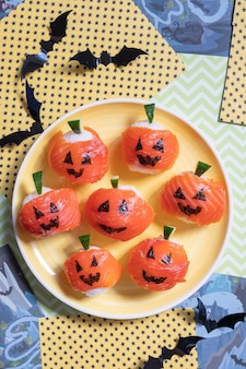 Zucche divertenti di halloween sushi jack o lantern