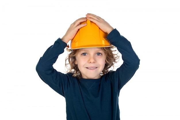 Divertente piccolo architetto con un casco rosa