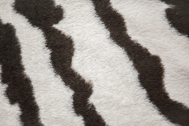 Tessuto in pelliccia con motivo di pelli di zebra