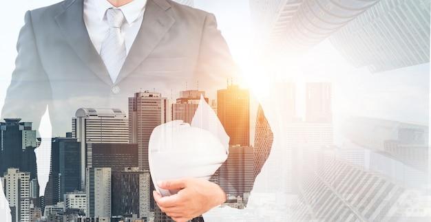 Futuro concetto di progetto di ingegneria edile con design grafico a doppia esposizione. ingegnere edile, architetto o operaio edile che lavora con la moderna tecnologia delle apparecchiature civili.
