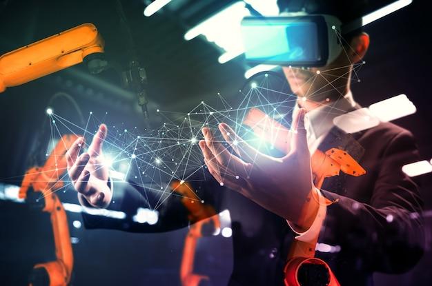 Tecnologia vr futura per il controllo meccanizzato del braccio robotico dell'industria