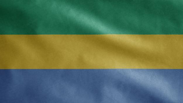 Bandiera del gabon sventolare nel vento. close up gabon banner soffiando, seta morbida e liscia