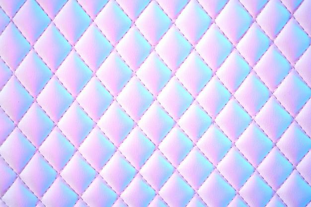 Pelle di pu trapuntata con sfondo geometrico a diamante in luce al neon