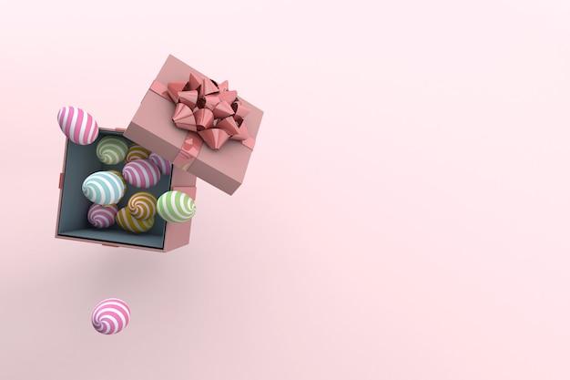 Confezione regalo e uova dipinte su rosa