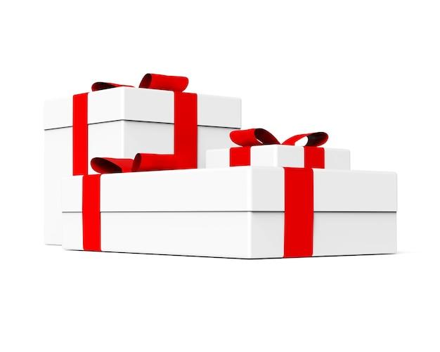 Confezione regalo di colore bianco con nastro rosso e fiocco su sfondo bianco set di tre oggetti