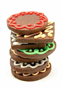 Biscotti allo zenzero e cioccolato decorati con glassa colorata